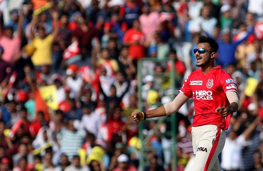 Punjab keep playoff hopes alive with win over RCB