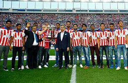 Atletico de Kolkata team and officials at the Vicente Calderon Stadium with the ISL Trophy