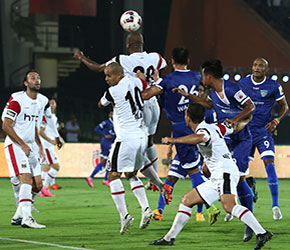 NorthEast United FC and Chennaiyin FC players in action vie for the aerial ball