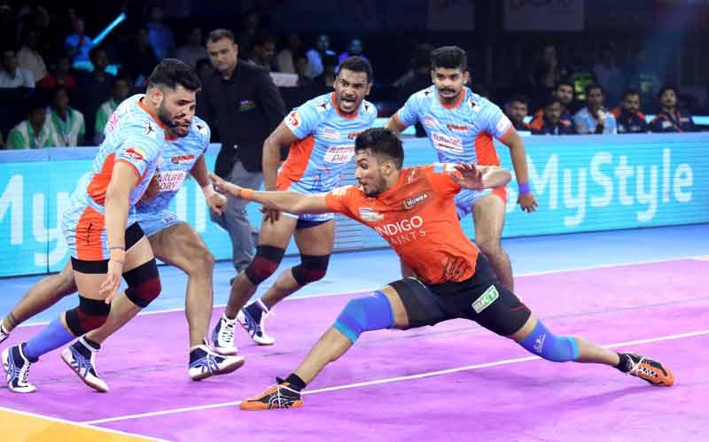 Arjun Deshwal of U Mumba tries to raid past the strong defence of Bengal Warriors