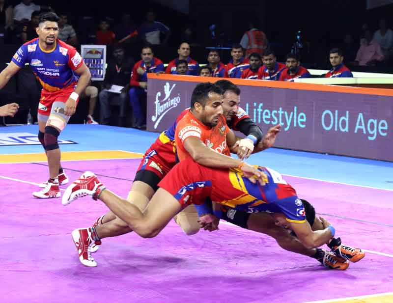 Sandeep Narwal being tackled by UP Yoddha